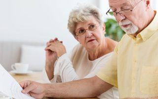 Senior couple working on taxes