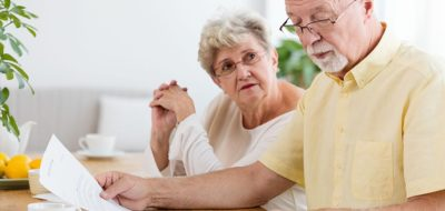 Senior couple working on taxes