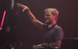 Avicii performing on stage